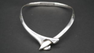 A contemporary Mexican silver cross over collar necklace with secure push catch. Stamped 925,