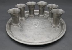A vintage pewter tray and six matching beakers bearing the Touring Club of Switzerland crest with