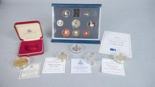 Five coins and a proof set, including a cased 22ct gold plated on silver coin with St Paul's