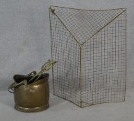 A 19th century brass coal bucket with tongs along with a brass folding mesh fire guard. H.75 W.61cm