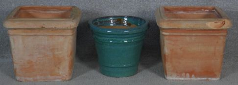 A pair of square tapering terracotta garden pots along with a drip glazed pot. H.26 L.28 W.29cm (