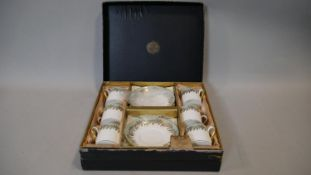 A Hammersley six person gilded fern and pale blue design boxed coffee set, as new D.13cm (Saucer)