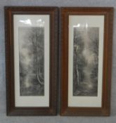 A pair of late 19th century carved oak framed and glazed greyscale prints of woodland river scenes