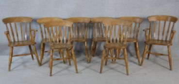 A set of eight 19th century fruitwood stick back dining chairs with moulded seats on turned