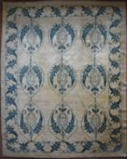 An old Tibet carpet with repeating floral motif across the fawn field contained by scrolling foliate
