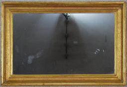 A 19th century moulded gilt framed wall mirror. H.53 W.78.5cm