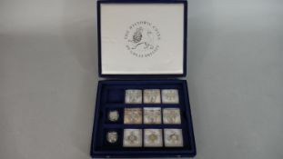 A box of eleven silver proof pound coins in capsules, nine with COA's in blue velvet partitioned