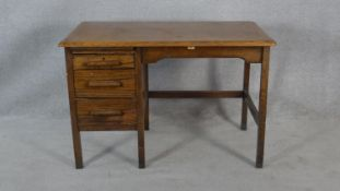 A mid century Edgleys oak and metal framed industrial style pedestal desk with maker's label to