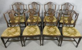 A set of eight Hepplewhite style mahogany dining chairs with carved and pierced back splats above