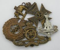 Five military cap and collar badges. Including a WW1 King's Royal Rifle Corps cap badge, a Royal