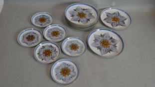 Eight Denby/Langley pottery floral design glazed dinner plates and six matching small plates. Makers