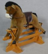 A vintage style Merrythought plush fabric rocking horse on a swing stand. H.98 L.108cm