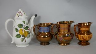 Three antique copper lustre ware pitchers along with a Port Merion Pomona design coffee pot with