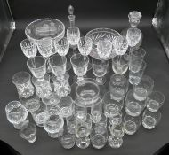 An extensive collection of glass to include cut crystal, drinking glasses, decanters, comports, wine