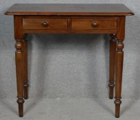 A 19th century mahogany hall table with frieze drawers on turned tapering supports. H.73 W.83.5 D.
