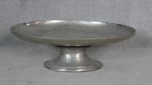 A large contemporary pewter oval pedestal serving/display platter. H.21 L.65.5 W.47cm