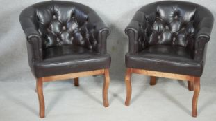A pair of piped and buttoned back leather tub chairs on cabriole supports. H81. W63. D77