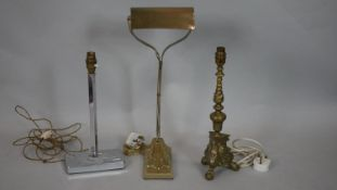 A vintage brass banker's desk lamp on scroll base, an Art Deco lamp base and a brass ecclesiastic