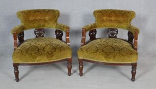 A pair of late Victorian carved mahogany framed tub armchairs in cut floral velour upholstery on