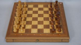 A 1980's Mephisto Exclusive hardwood modular chess board with pieces. (Complete) H.5 L.41 W.40.5cm