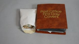 A large collection of loose world stamps and a Post Office leather effect binder of various first