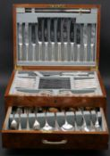 A burr walnut cased vintage six person canteen of sterling silver cutlery by Birmingham Plate &