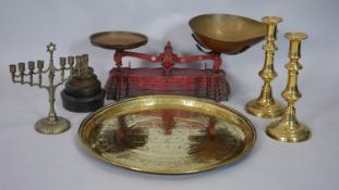 A vintage set of Miles & Co red weighing scales with set of weights, an antique engraved brass tray,