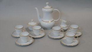 A Seltmann Weiden Bavaria porcelain coffee set for six. Each piece with a gilded foliate garland