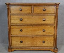 A late Victorian Aesthetic movement pitch pine chest of drawers with painted and ebonised decoration
