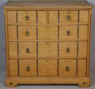 A late Victorian Aesthetic movement pitch pine chest of drawers with ebony and satinwood inlay and