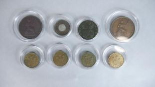 Eight coins. Including a Victorian one penny model coin, four three pence coins, dated 1941, 42,