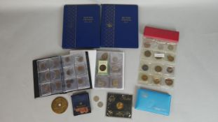 A miscellaneous collection of coins. To include a quantity of British pennies in two Whitman