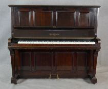 A Boyd of London mahogany cased upright piano with maker's mark to the iron frame. H.131.5 W.148 D.