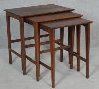 A 1970's vintage teak nest of three graduating occasional tables. H.53.5 L.53.5 W.38cm (Largest)