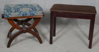 A 19th century mahogany piano stool with rise and fall action and floral loose cover and a