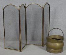 A brass helmet shaped coal scuttle and a four panel mesh fireguard. H.82 W.33cm (Fireguard folded)