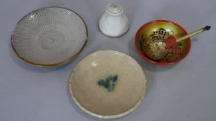 A collection of ceramics and lacquered items. Including two glazed ceramic plates one with linear
