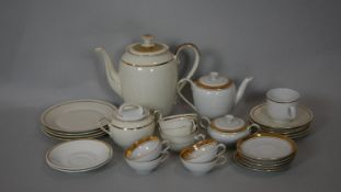 A collection of gilded dinner ware. Including a Mitterteich Bavarian gilded part four person