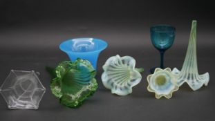 A collection of coloured and etched glass and uranium glass epergnes along with a coloured liquor