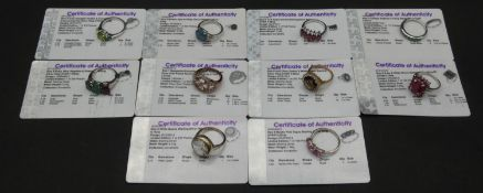 Ten gem set rings with certificates. To include a three stone mystic pink topaz and silver ring, a