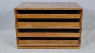A vintage teak plan chest or linen cabinet fitted with slides on plinth base. H.69 W.101.5 D.66cm