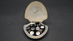 A cased set of vintage Krementz golled filled, white metal and mother of pearl dress set in original