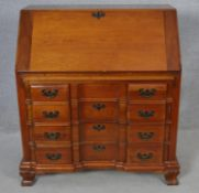 A 19th century Continental style fruitwood bureau with fully fitted interior on shaped squat bracket