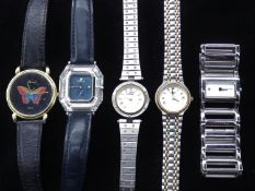 A collection of five ladies watches. To include a Swarovski 'Crystal Time' ladies watch with blue