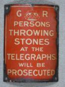 A vintage enamel and metal warning notice by order of King George. 20x16cm