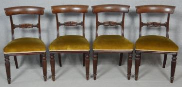 A set of four William IV mahogany bar back dining chairs with acanthus carved splats above stuff