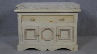 A Continental painted side cabinet with sandstone slab top on shaped bracket feet. H.67 W.91 D.61cm