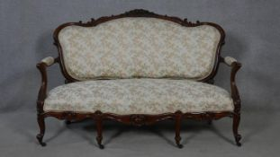 A 19th century carved mahogany canape in floral upholstery with four cabriole front supports. H.99