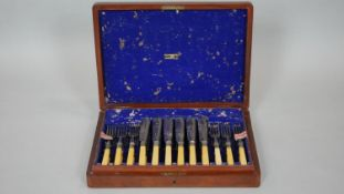 A complete six person oak canteen of Walker & Hall fish knives and forks. With ivorine handles and