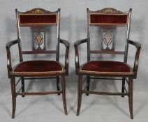 A pair of late Victorian rosewood armchairs with satinwood and ivory scrolling foliate urn inlay